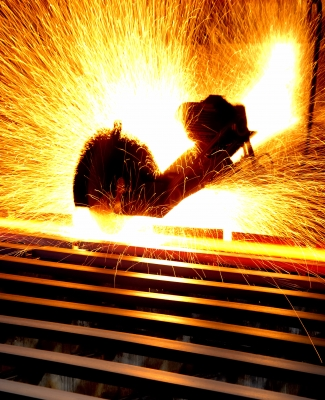 Cutting steel work as part of a manufacturing process